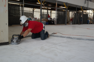 Diamond grinding the floor: This small diamond grinder is used for edges, drains, and small areas